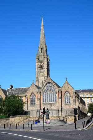 View of St Marys Cathedral with people sitting on the steps in the foreground, Newcastle upon Tyne, Tyne and Wear, England, UK, Western Europe.