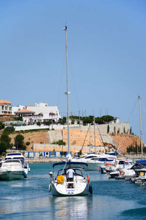 Boats and yachts in the marina with buildings to the rear, Albufeira, Algarve, Portugal, Europe. Editorial