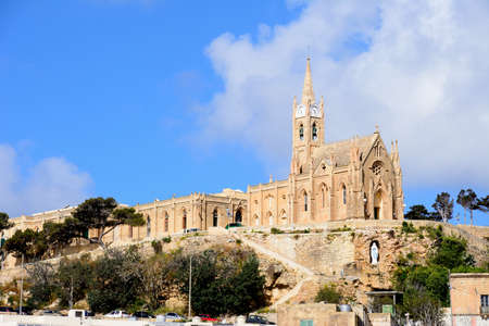 View of Our Lady of Lourdes church on the hillside, Mgarr, Gozo, Malta, Europe.