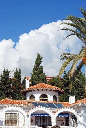 Pretty whitewashed villa with solar panels on the roof in the Torre Blanca area, Fuengirola, Costa del Sol, Andalusia, Spain, Europe.
