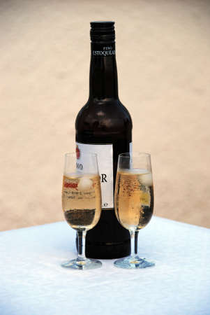 Two glasses of fino sherry with the bottle to the rear, Andalusia, Spain.
