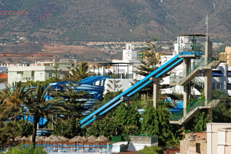View of the large water slides in the water park with mountains to the rear, Fuengirola, Malaga Province, Andalusia, Spain, Western Europe. Editorial