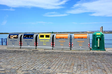 Recycling bins along the waterfront with views across the River Guadiana towards Castro Marim in Portugal, Ayamonte, Huelva Province, Andalucia, Spain, Europe. Editorial