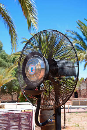 Electric cooling fan in the castle courtyard, Silves, Portugal, Europe.