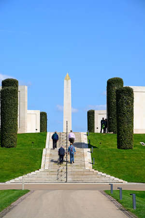 Group of people walking up the steps to the front of the Armed Forces Memorial, National Memorial Arboretum, Alrewas, Staffordshire, England, UK, Western Europe. Sajtókép