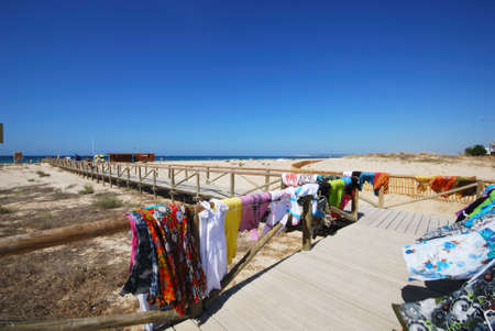 ZAHARA DE LOS ATUNES, SPAIN - SEPTEMBER 14, 2008 - Clothes for sale on the wooden pathway on the beach, Zahara de los Atunes, Cadiz Province, Andalusia, Spain, Europe, September 14, 2008.