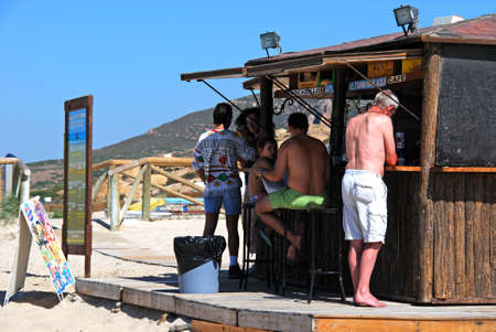 ZAHARA DE LOS ATUNES, SPAIN - SEPTEMBER 14, 2008 - Tourists relaxing at a wooden beach bar on the beach, Zahara de los Atunes, Cadiz Province, Andalusia, Spain, Europe, September 14, 2008.