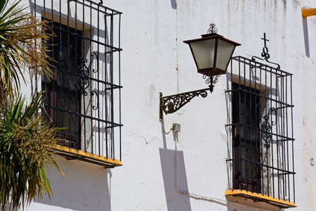 Windows on the front right hand side of the Las Angustias Parish church (Parroquia De Nuestra Senora De Las Angustias) with wrought iron grills topped with crosses, Ayamonte, Huelva Province, Andalucia, Spain, Europe.