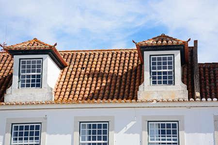 Traditional Portuguese building with dormer windows in the Praca do Marques de Pombal (Marquis of Pombal Square), Vila Real de Santo Antonio, Algarve, Portugal, Europe.