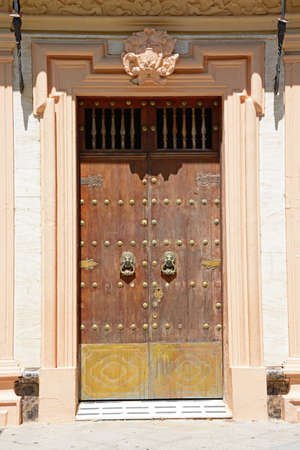 Wooden studded front door with brass fittings on the front of the town hall, Ayamonte, Huelva Province, Andalucia, Spain, Europe.