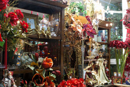 Christmas decorations and flowers in shop window at night, Fuengirola, Costa del Sol, Malaga Province, Andalucia, Spain, Europe.