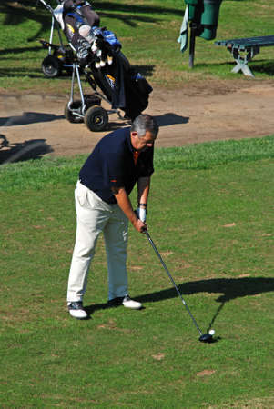 MARBELLA, SPAIN - NOVEMBER 12, 2008 - Man playing golf on the putting green at the Rio Real Golf Club, Marbella, Costa del Sol, Malaga Province, Andalucia, Spain, Europe, November 12, 2008.