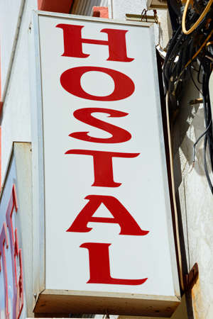 Red and white Hostal sign on a wall, Ayamonte, Huelva Province, Andalucia, Spain, Europe.