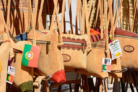 Traditional Portuguese cork handbags for sale in the old town, Albufeira, Algarve, Portugal, Europe.