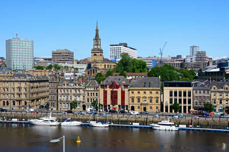 View across the River Tyne towards Newcastle upon Tyne with the church of Saint Willibrord with All Saints clock tower to the centre, Newcastle upon Tyne, Tyne and Wear, England, UK, Western Europe.