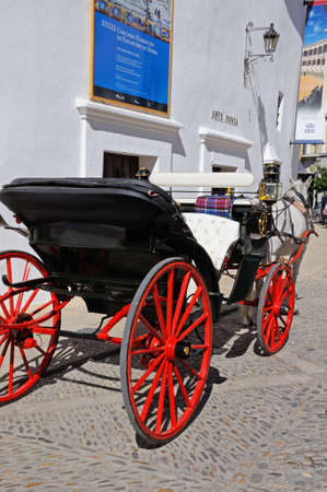 RONDA, SPAIN - OCTOBER 24, 2009 - Horse drawn carriage parked outside the bullring, Ronda, Malaga Province, Andalucia, Spain, Europe, October 24, 2009. Éditoriale