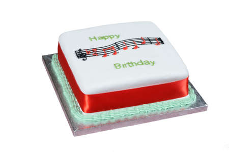 Happy Birthday music and text atop a square white cake