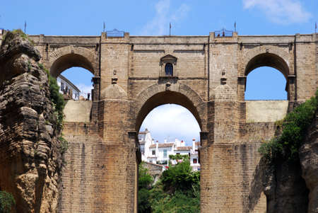 View of the top part of the new bridge with town buildings to the rear, Ronda, Malaga Province, Andalucia, Spain, Europe. Stock fotó