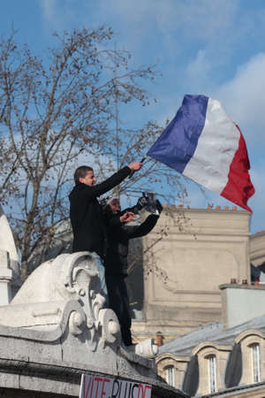 satirical: People waving french flag during manifestation on Republic Square in Paris against terrorism and in memory of the attack against satirical newspaper Charlie Hebdo-January 11, 2015. France Editorial