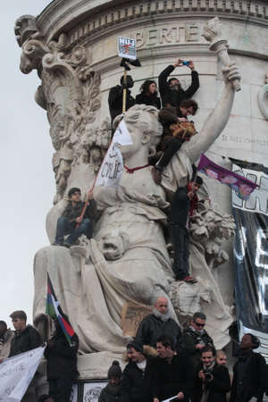 satirical: People on statue of republic DURING event on Republic Square in Paris Against Terrorism and in memory of the attack Against satirical newspaper Charlie Hebdo-January 11, 2015. France Editorial