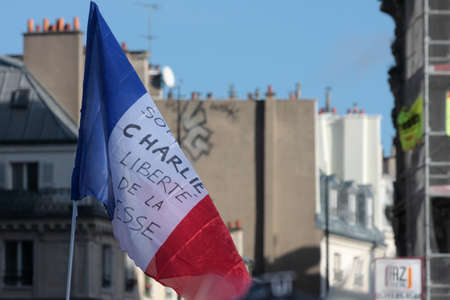 satirical: French flag during manifestation on Republic Square in Paris against terrorism and in memory of the attack against satirical newspaper Charlie Hebdo-January 11, 2015. France