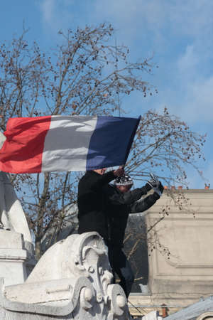 fraternity: People waving the French flag.during manifestation on Republic Square in Paris against terrorism and in memory of the attack against satirical newspaper Charlie Hebdo-January 11, 2015. France