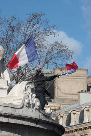 satirical: Black people waving the French flag.during manifestation on Republic Square in Paris against terrorism and in memory of the attack against satirical newspaper Charlie Hebdo-January 11, 2015. France