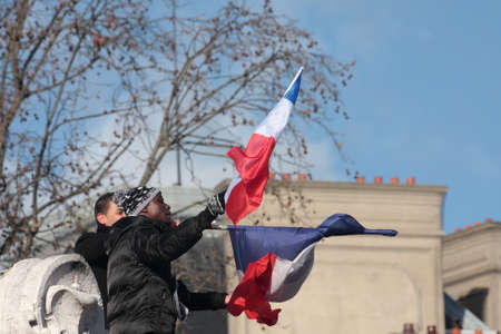 fraternity: Black people waving the French flag.during manifestation on Republic Square in Paris against terrorism and in memory of the attack against satirical newspaper Charlie Hebdo-January 11, 2015. France