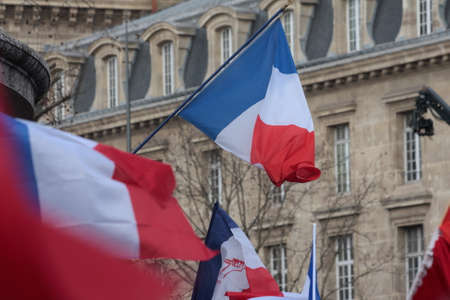 fraternity: French flag during manifestation on Republic Square in Paris against terrorism and in memory of the attack against satirical newspaper Charlie Hebdo-January 11, 2015. France