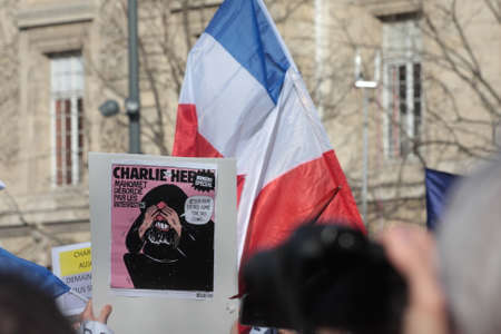 fraternity: Caricature drawing DURING event on Republic Square in Paris Against Terrorism and in memory of the attack Against satirical newspaper Charlie Hebdo-January 11, 2015. France
