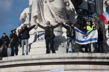 satirical: Israeli flag Pendant event on Republic Square in Paris Against Terrorism and in memory of the attack Against satirical newspaper Charlie Hebdo-January 11, 2015. France Editorial