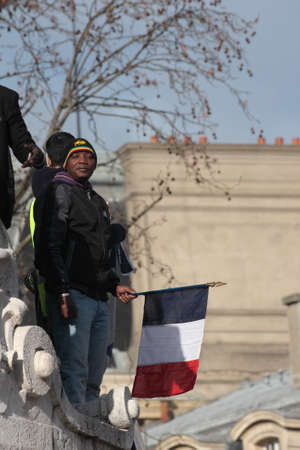 fraternity: Black people waving the French flag.during event on Republic Square in Paris Against Terrorism and in memory of the attack Against satirical newspaper Charlie Hebdo-January 11, 2015. France Editorial