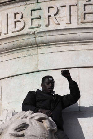 satirical: Black people singing Marseillaise DURING event on Republic Square in Paris Against Terrorism and in memory of the attack Against satirical newspaper Charlie Hebdo-January 11, 2015. France