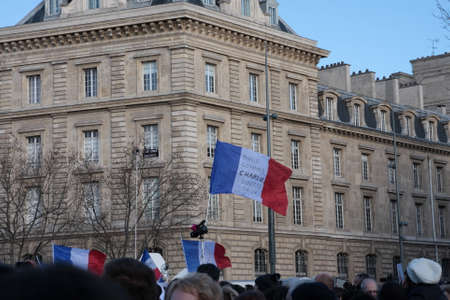 satirical: English flag Pendant event on Republic Square in Paris Against Terrorism and in memory of the attack Against satirical newspaper Charlie Hebdo-January 11, 2015. France