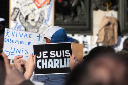 satirical: Banner DURING event on Republic Square in Paris Against Terrorism and in memory of the attack Against satirical newspaper Charlie Hebdo-January 11, 2015. France Editorial