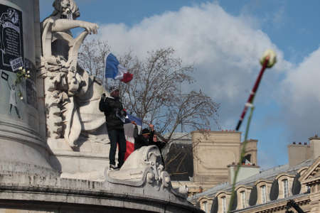 satirical: People waving french flag Pendant event on Republic Square in Paris Against Terrorism and in memory of the attack Against satirical newspaper Charlie Hebdo-January 11, 2015. France