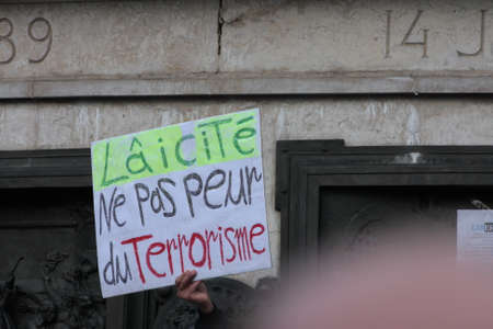 satirical: Banner Defending secularism DURING event on Republic Square in Paris Against Terrorism and in memory of the attack Against satirical newspaper Charlie Hebdo-January 11, 2015. France