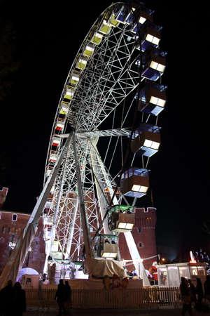 big wheel in christmas market, Perpignan, France Editorial
