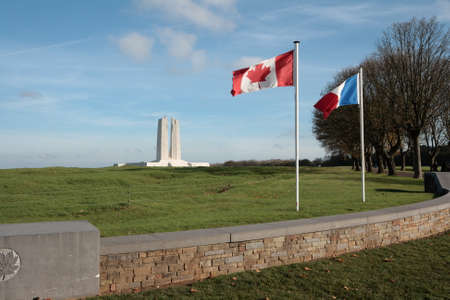 French and canadian flag at memorial of Vimy in North of France.