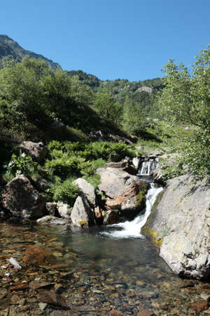Pyrenean river in Orlu valley in Ariege, Occitanie in south of France Stock Photo