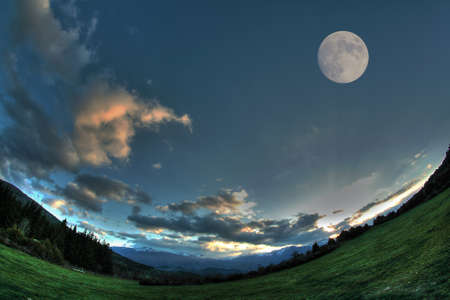 Moon in the sky, Pyrenees in France Stock Photo