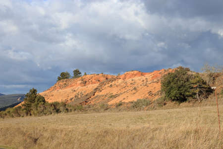 Red ochre lands or ocher lands in Corbieres, Aude, Occitanie in south of France