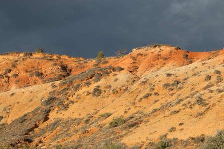 ferrous: Red ochre lands or ocher lands in Corbieres, Aude, Occitanie in south of France