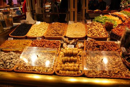 Dried fruit stand at the market La Boqueria, Barcelona.