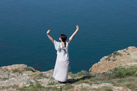 Woman alone facing the Mediterranean Sea, Pyrenees orientales in southern of France