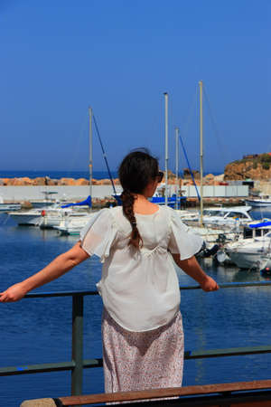 Young woman alone discovering a Mediterranean port, Port Vendre in Pyrenees orientales, France
