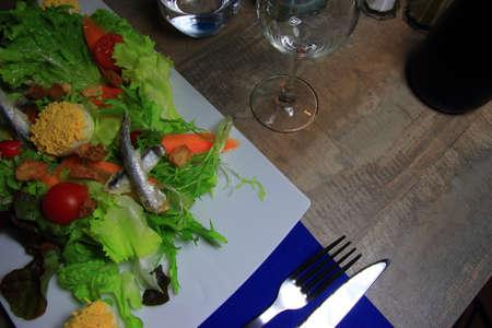 Salad prepared with mimosas eggs  in a French restaurant Archivio Fotografico