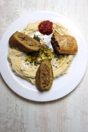 Prepared plate of kibbeh, bourek and hummus, middle eastern cuisine