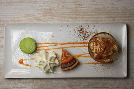 dessert plate, macaroon, cream, pie and chantilly