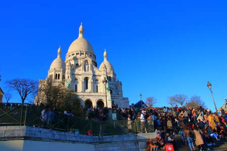 Basilica of Sacre coeur and visiting tourists in Paris, France Editöryel